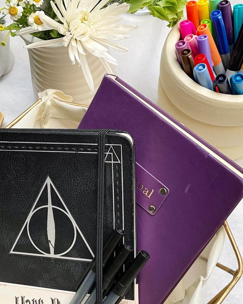 notebooks with paper mate pens and sharpie markers
