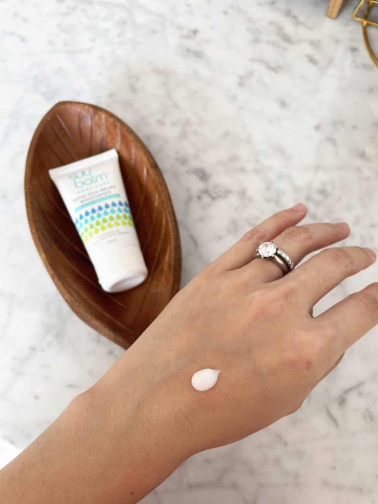 itchy skin treatment cream being applied on a hand