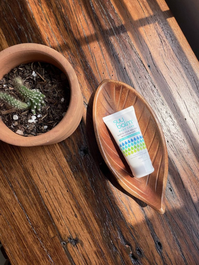 itchy skin treatment cream on a wooden tray